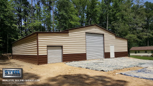 A large steel garage building with two garage doors.