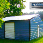 Steel building garage with blue walls and black trim.