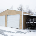 Metal carport used for boat storage used as a ridgeline barn